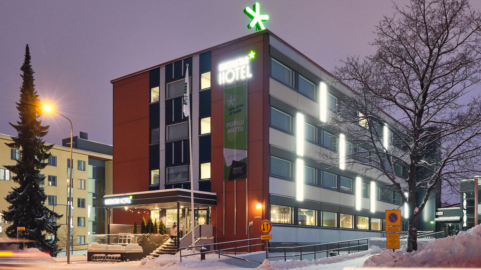 Hotel Green Star building in winter.