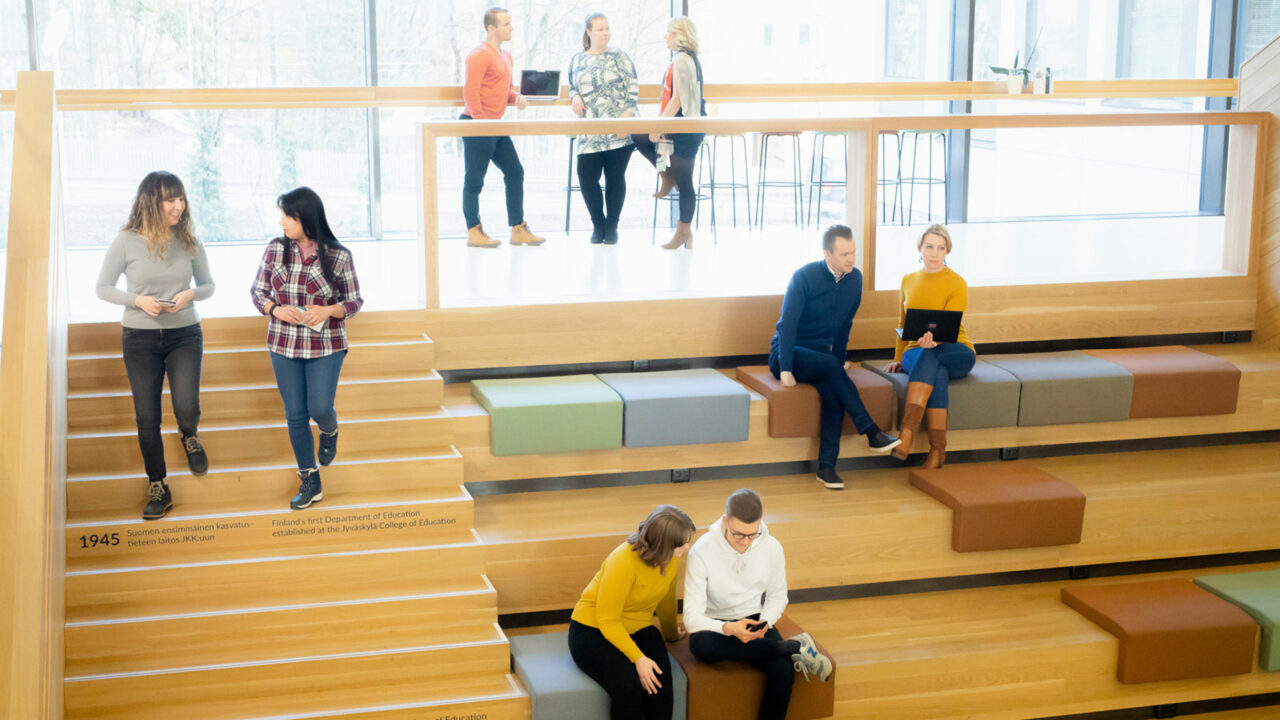 Persons sitting and walking on stairs.