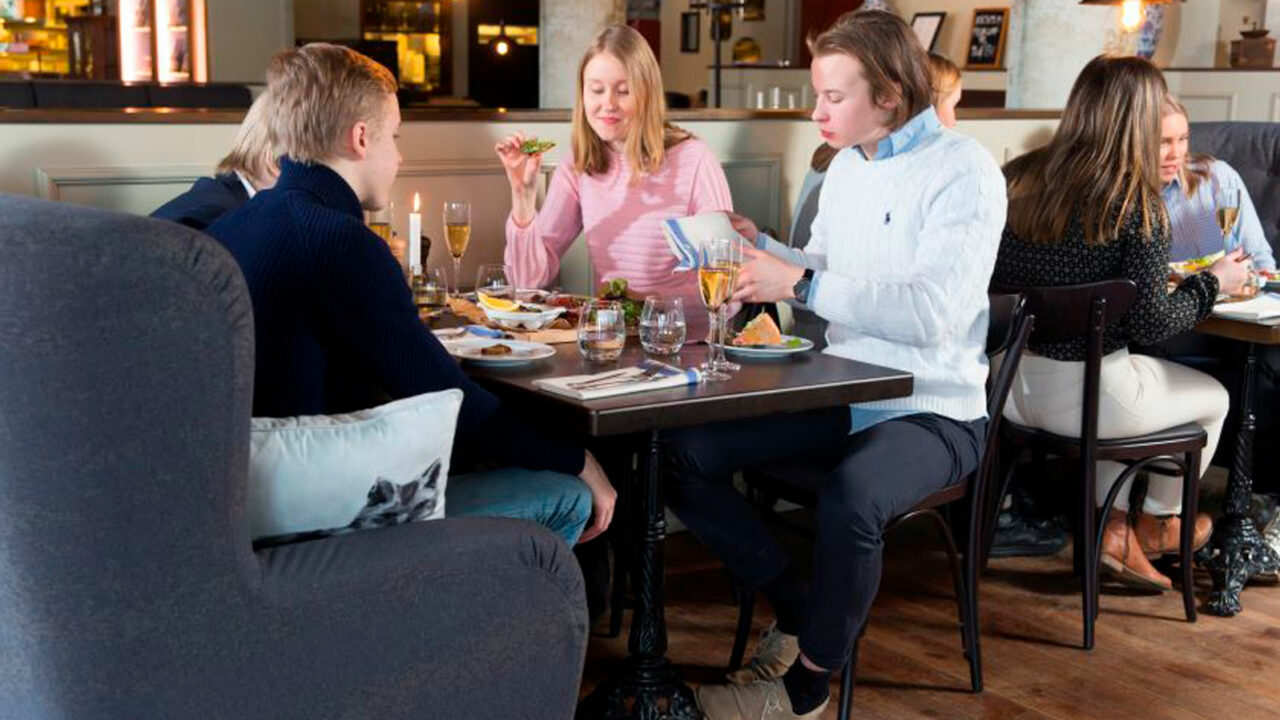 Persons eating in a restaurant.