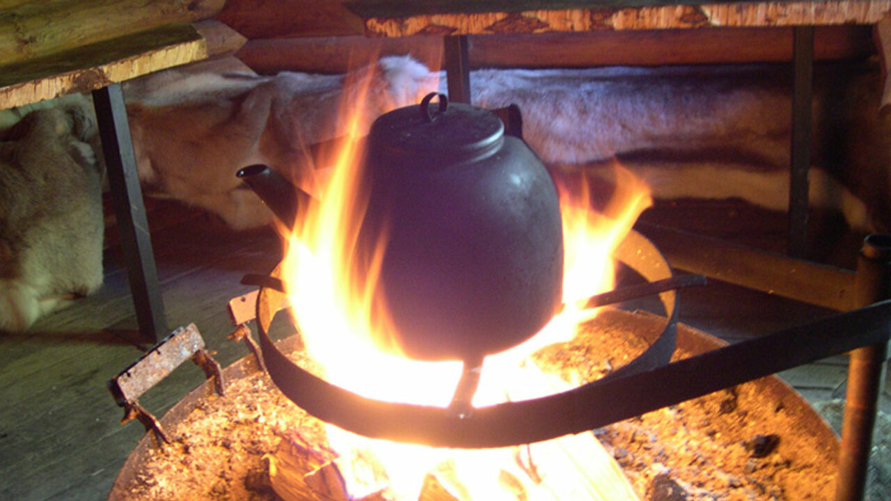 Coffee pot over an open fire.