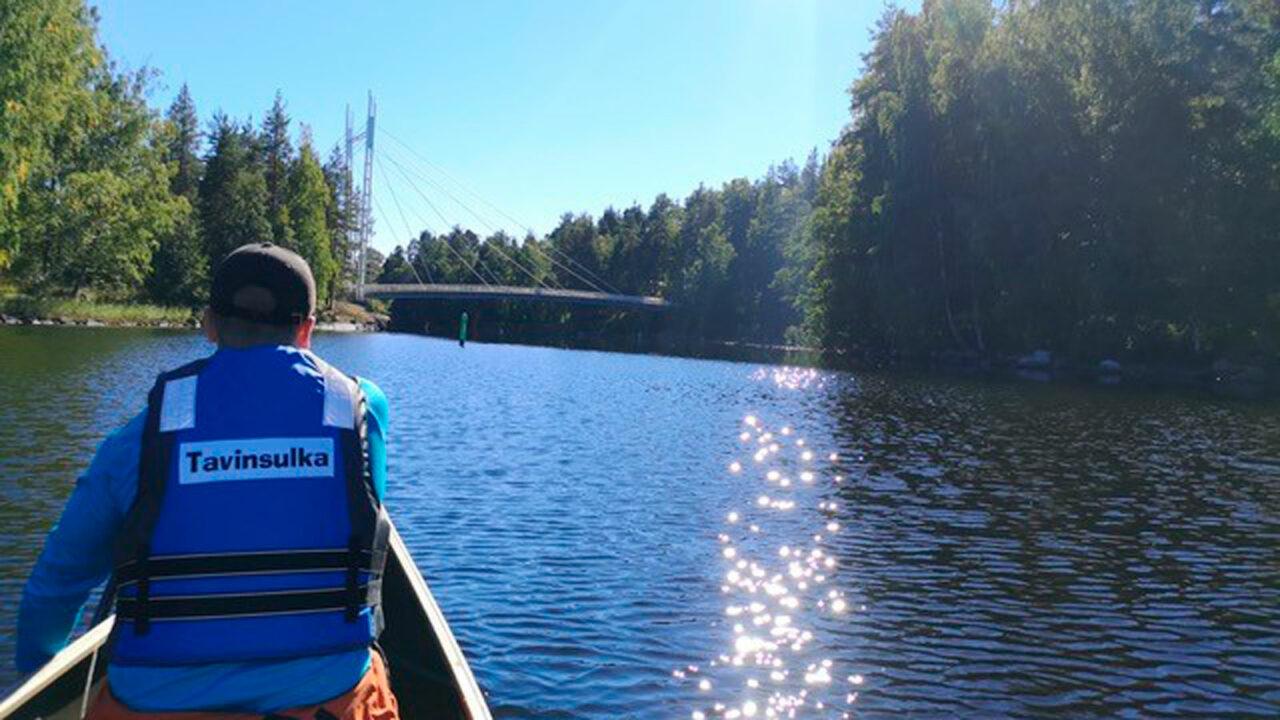 Person paddling.