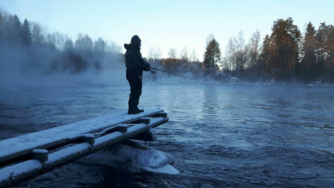 Person fishing in winter.
