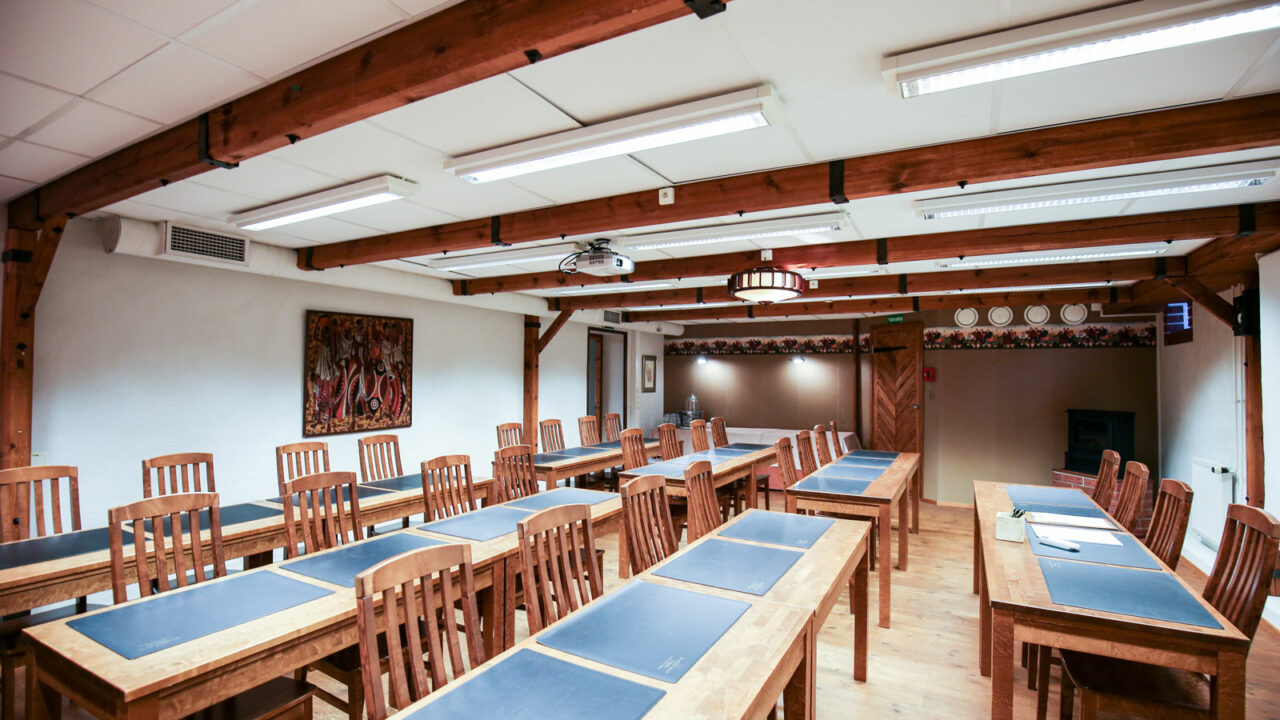 Meeting room with tables and chairs.
