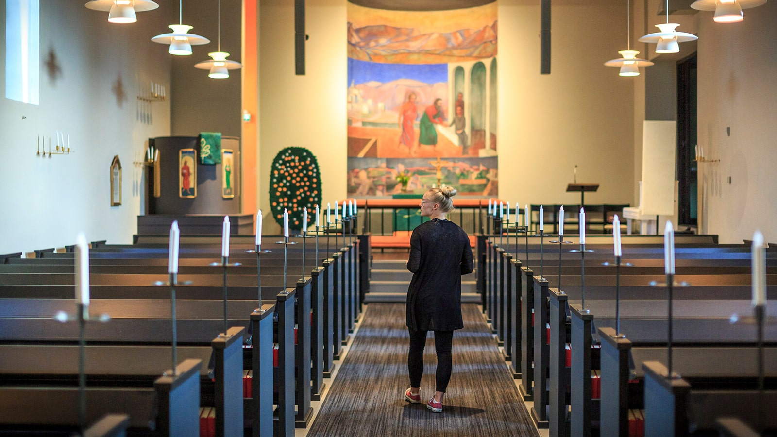 Person walks down the aisle of Muurame church