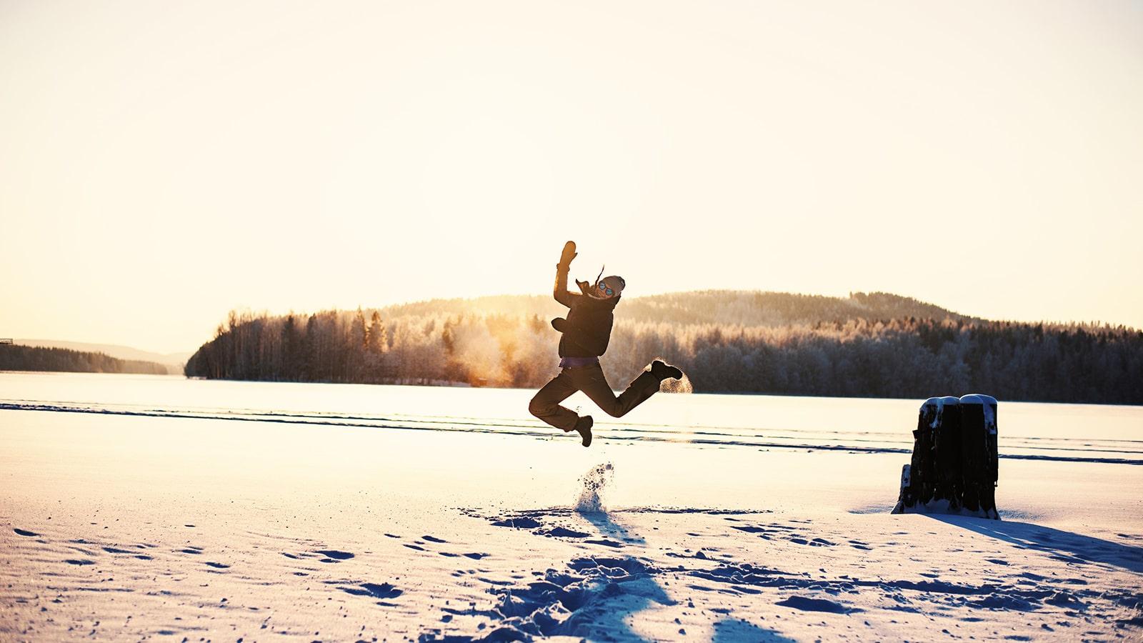 Person jumps on the ice of the Lake Jyväsjärvi on winter