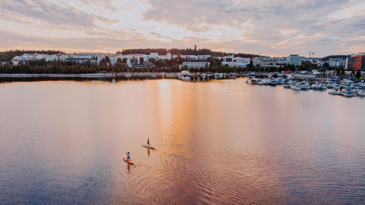 Aerial photo of two persons sup boarding in Jyväskylä