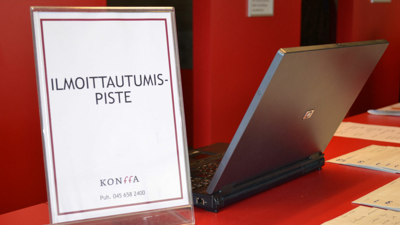 Computer and registration sign on the table.