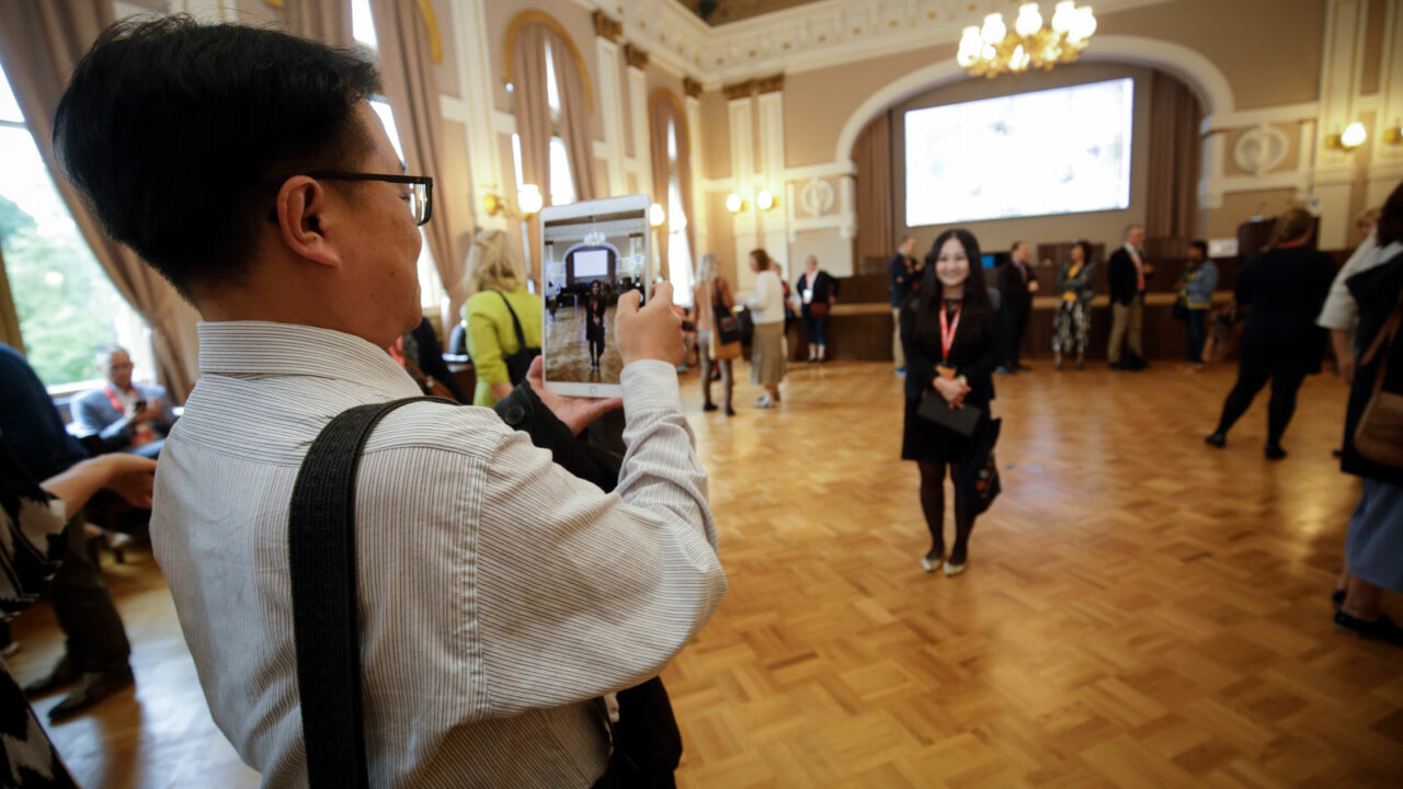 Person taking picture in city hall.