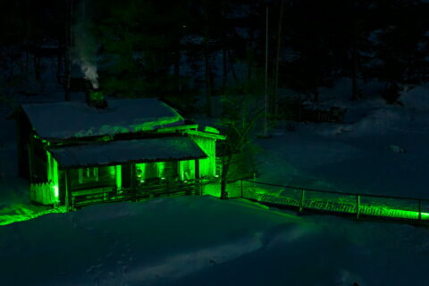 A sauna lightened up green.