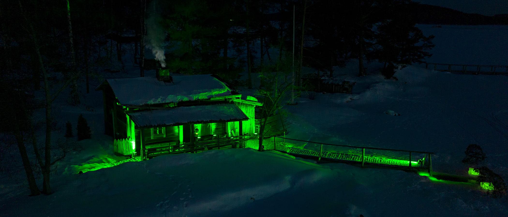 A sauna lightened up green.