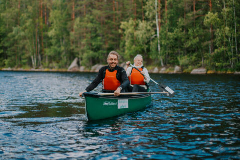 Two persons paddling in the Isojärvi National Park