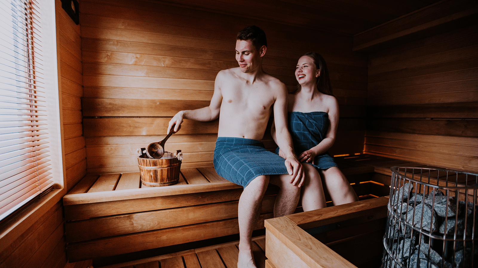 Two persons sitting in sauna