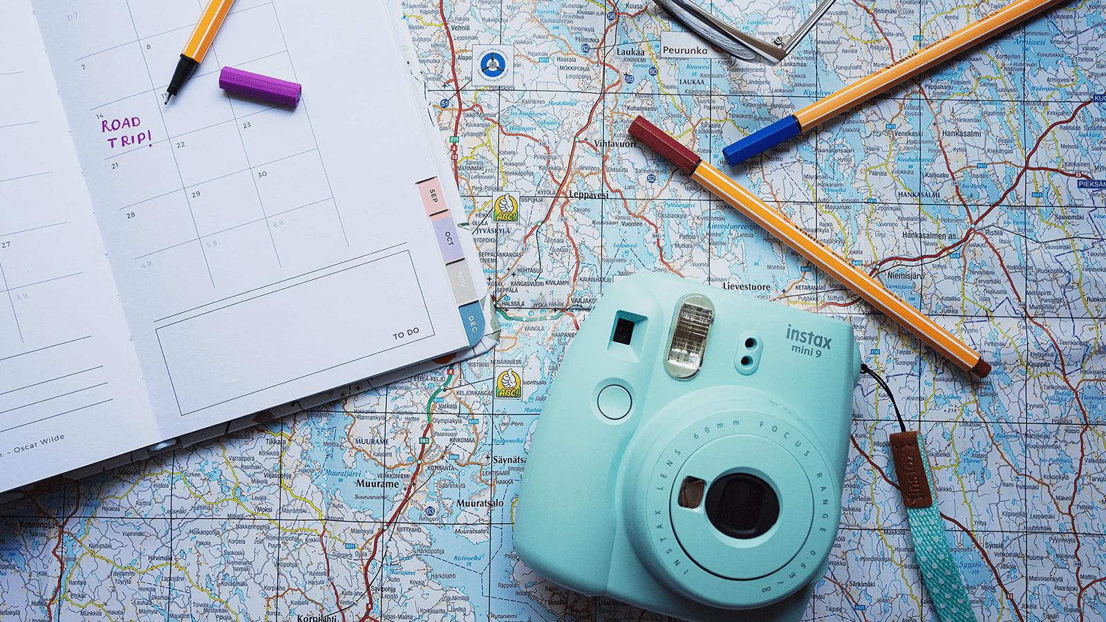 Display of a camera, pens, a calendar and a map