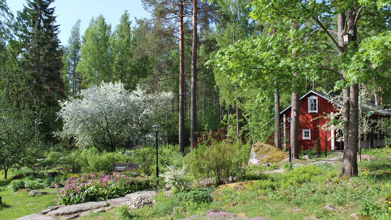 Red cabin in a lush garden