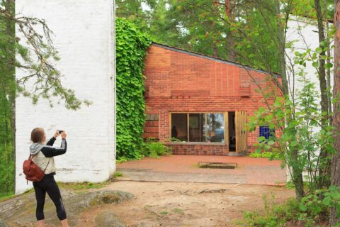 A person taking a picture of Muuratsalo experimental house