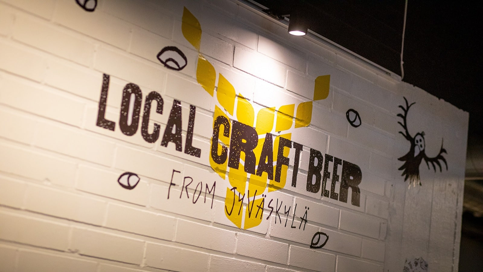 Local craft beer from Jyväskylä -text in the wall of HIISI brewery.