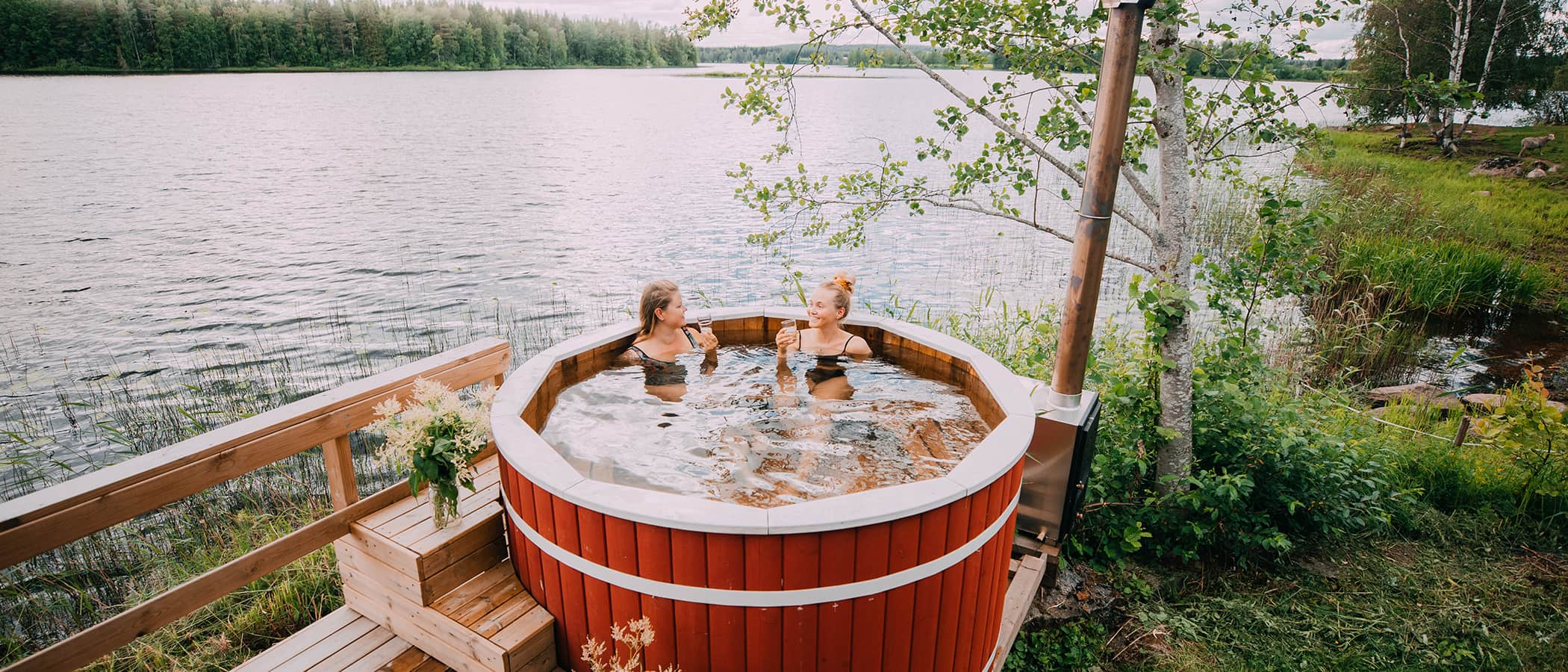 Two persons sitting in a hot tub