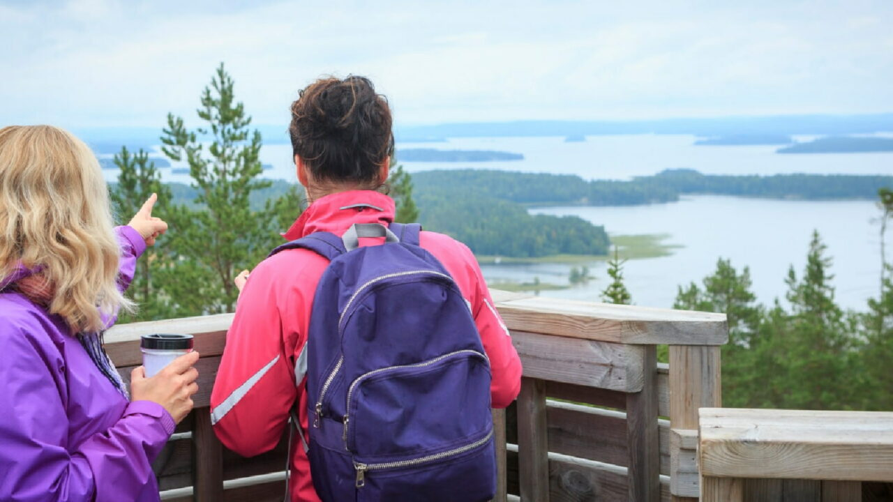 Two persons at Oravivuori Triangulation Tower watching the views