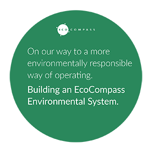 EcoCompass logo in english: On our way to a more environmentally responsible way of operating. Building an EcoCompass Environmental System.