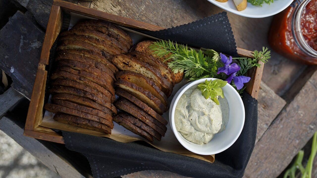 Bread basket with herbs and sauce