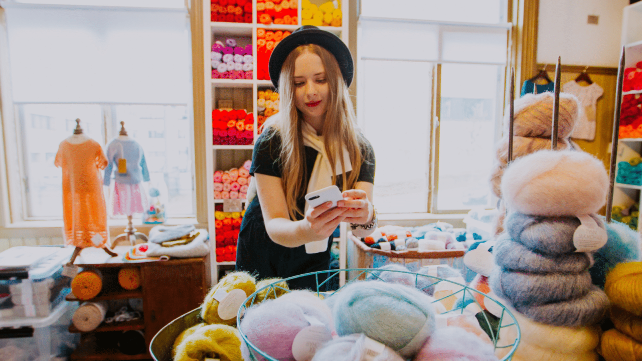 One person shopping and taking a photograph