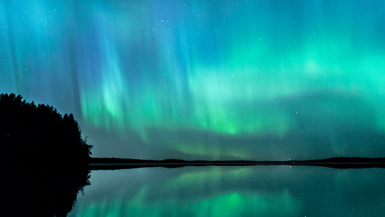 Northern Lights in the sky above a lake