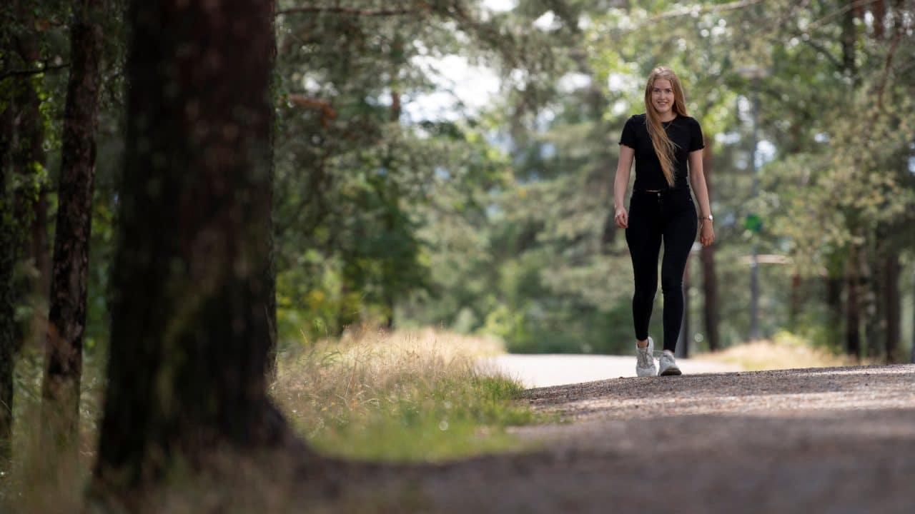 Julie Weien Forøy walking down a forest path in the Jyväskylä region.