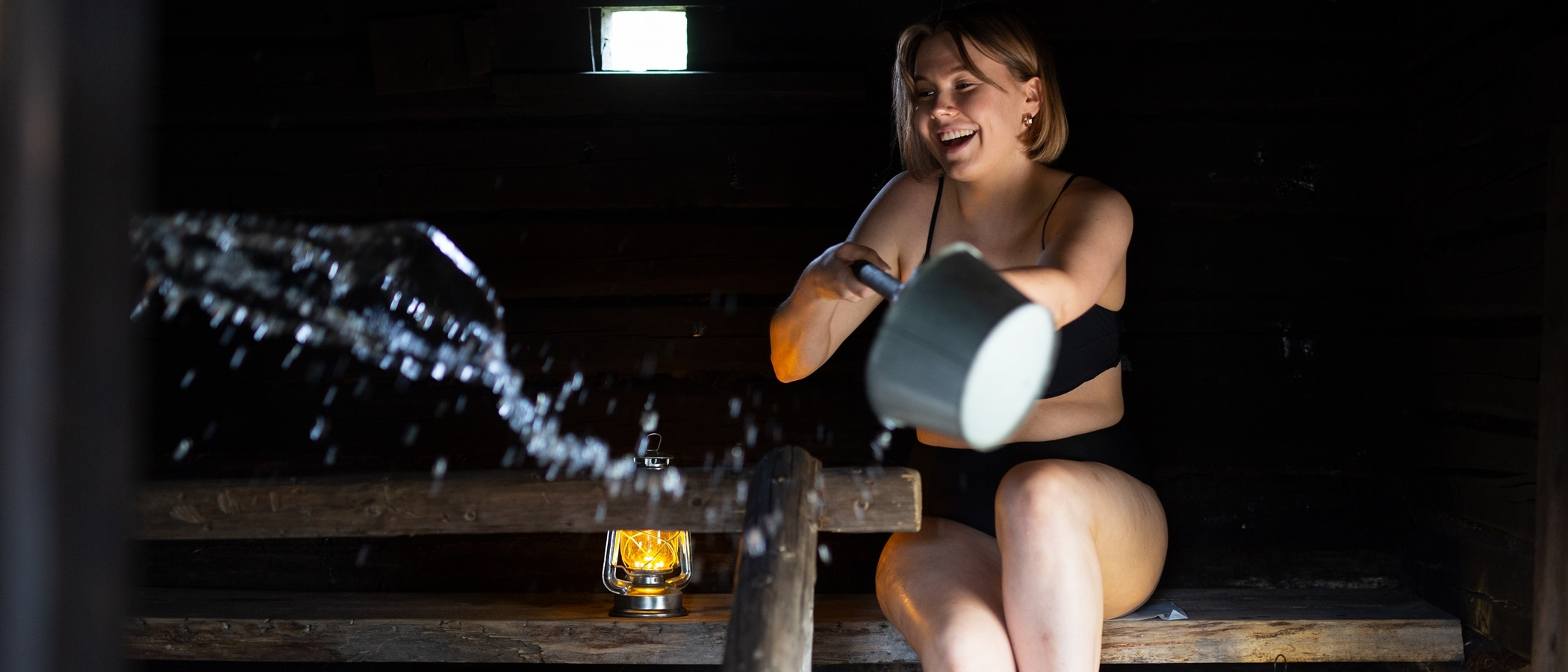 Person bathing in a sauna